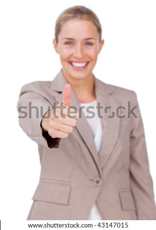 Successful businesswoman with thumb up against a white background