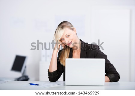 Successful businesswoman working with laptop on the table