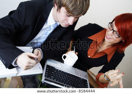 successful caucasian manager with young beautiful consultant - stock photo