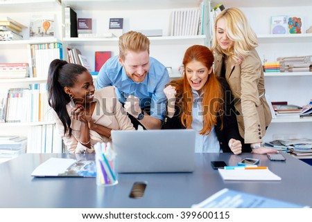 Successful company celebrates business success with coworkers being happy - stock photo