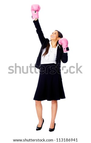 Successful competitive businesswoman is happy and and has boxing gloves while wearing a suit and isolated on white background - stock photo