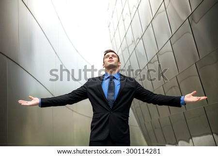 Successful conceptual businessman executive CEO winning interesting background arms raised glory - stock photo