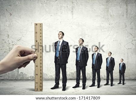 Successful confident businessmen standing in line. Progress in career - stock photo