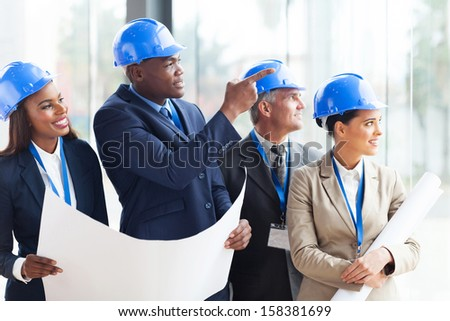 successful construction team discussing architectural project - stock photo