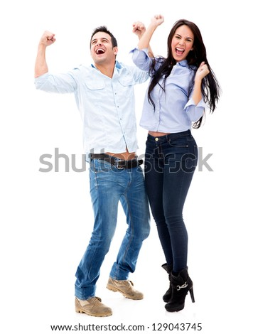 Successful couple celebrating - isolated over a white background
