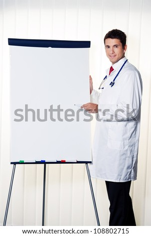 successful doctor with a flip chart during a presentation in meeting - stock photo