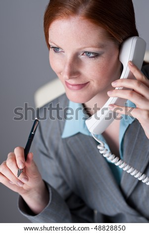 Successful executive businesswoman on the phone at office