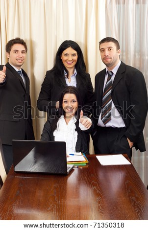 Successful four business people in a meeting room - stock photo