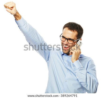 Successful gesturing business man with mobile  - stock photo