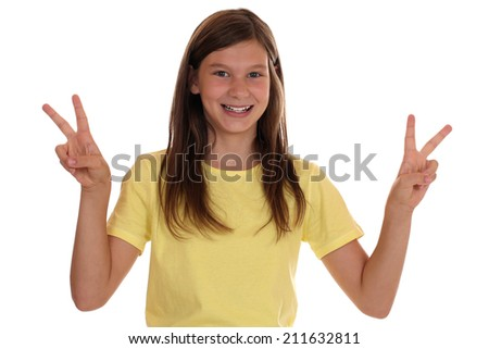 Successful girl making the victory sign, isolated on a white background