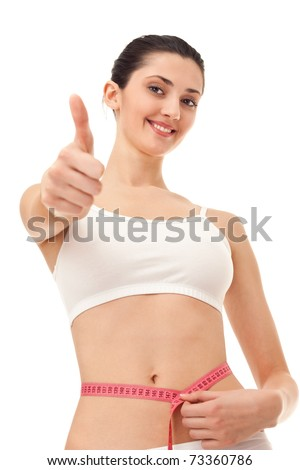 successful girl measuring her belly, giving a thumbs up, isolated on white - stock photo