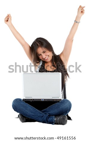 Successful girl on a laptop working on the floor with her arms up over a white background