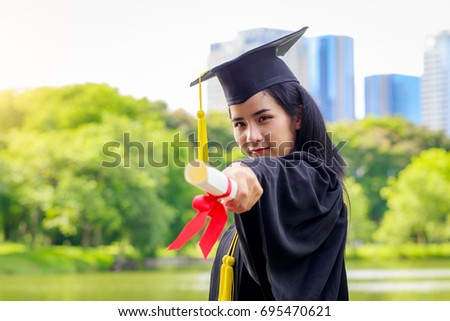 successful graduating student wearing cap gown stock photo  successful graduating student wearing cap and gown holding diploma
