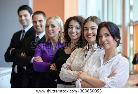 Successful group of business people in office