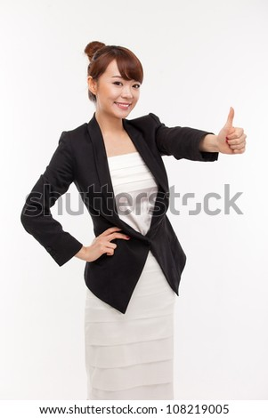 Successful happy Asian businesswoman showing thumb. - stock photo