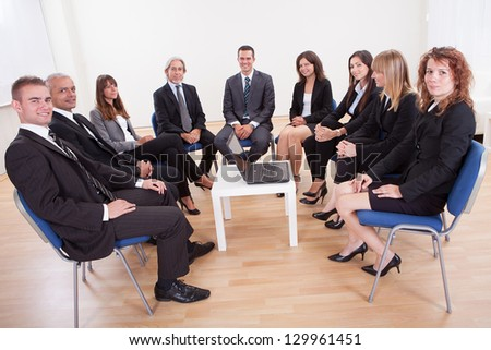 Successful Happy Business People Sitting On Chairs In Meeting
