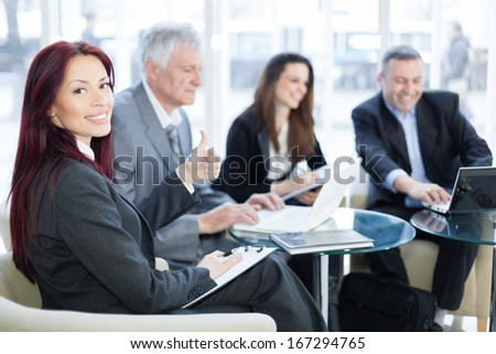 Successful happy business people using laptop and talking about a work. Shallow depth of field. Please see more photos and video ( Business concepts ).  - stock photo
