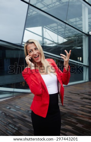 Successful happy female talking on cell phone, elegant lady in corporate clothing have telephone conversation outdoors, confident luxury businesswoman talk on smart phone standing near office building - stock photo