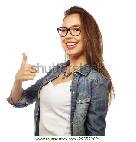 Successful happy girl gives thumb up with two hands - stock photo