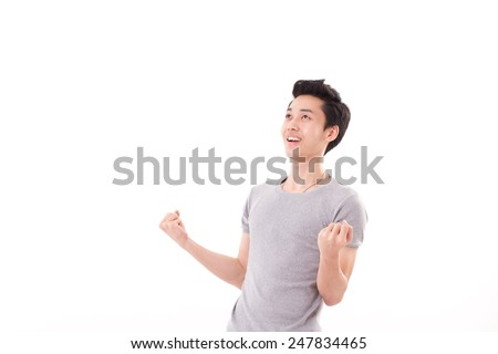 successful, happy man looking up - stock photo