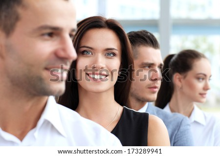 Successful happy woman with business group    - stock photo