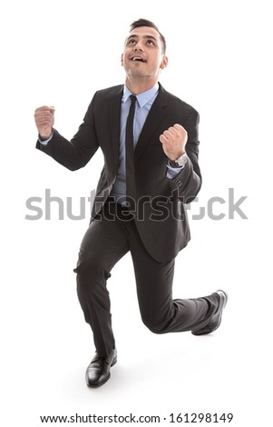 Successful happy young businessman - isolated - tie and suit - expression of success - career concept