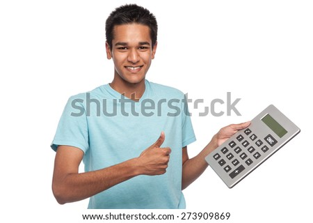 Successful happy young man with big calculator.