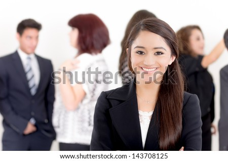 Successful hispanic young business woman at the office - stock photo