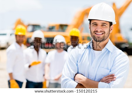 Successful male architect at a building site with arms crossed  - stock photo