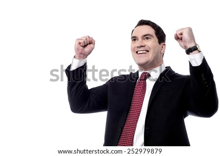 Successful male entrepreneur clenching his fists - stock photo