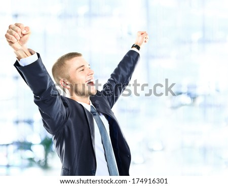 Successful man celebrating with arms up - stock photo