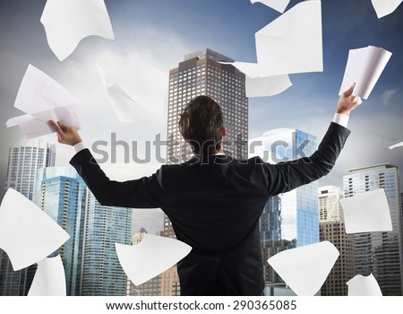 Successful man exults and throws work documents - stock photo