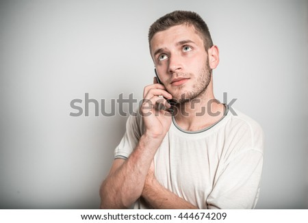 successful man funny talking on a cell phone, selfie - stock photo