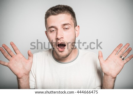 successful man pleasantly surprised by the news, isolated on a gray background