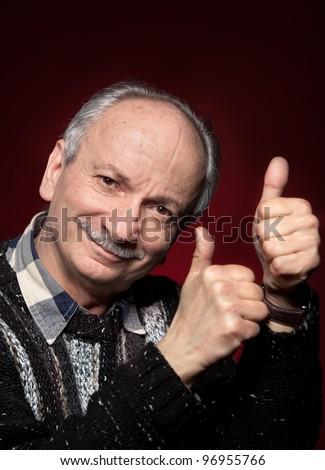 Successful man shows ok sigh - stock photo
