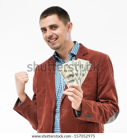 successful man with money in hand - stock photo