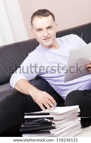 Successful man working at home. - stock photo
