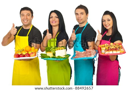 Successful market workers holding fresh products and giving thumbs up in a line isolated on white background