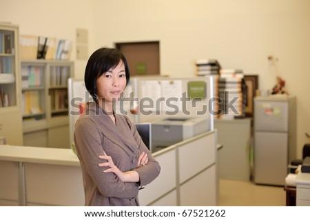Successful mature business woman, closeup portrait in office. - stock photo