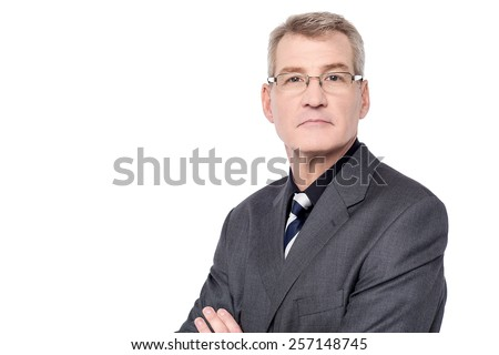 Successful mature businessman with folded arms