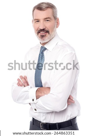 Successful mature businessman with folded arms - stock photo