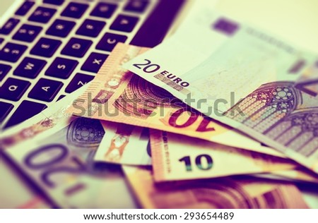 Successful Online Business Concept with Laptop Keyboard and Euro Bills. Making Money on the Internet Business Concept. - stock photo