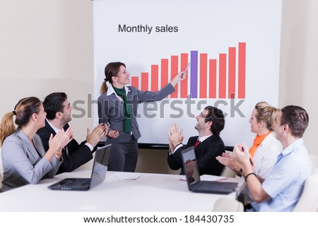 Successful presentation at a meeting - stock photo