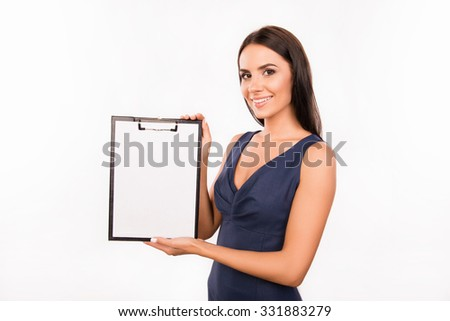 Successful pretty business woman demonstrating a file in a folder - stock photo