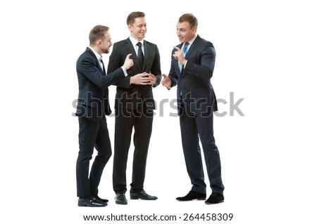 Successful project. Full length of three cheerful business people in formalwear discussing something and gesturing. Isolated on white. - stock photo