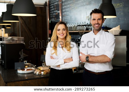 Successful restaurant managers standing together - stock photo