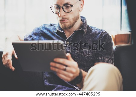 Successful Risk Trader working device modern Interior Design Loft Office.Men work Vintage Sofa,Using contemporary tablet Hand Texting.Blurred Background.Business Startup Idea Process.Closeup photo - stock photo