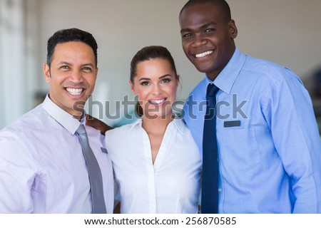 successful sales staff at a car dealership - stock photo