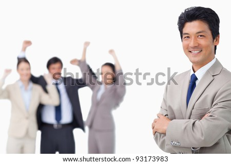 Successful salesman getting celebrated by colleagues against a white background - stock photo