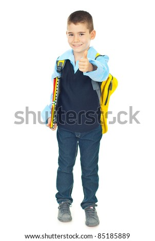 Successful schoolboy in first day of school giving thumb up isolated on white background - stock photo